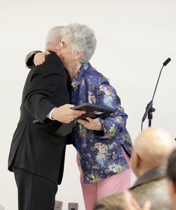 Father Gargani receives award from Rosemarie Pace